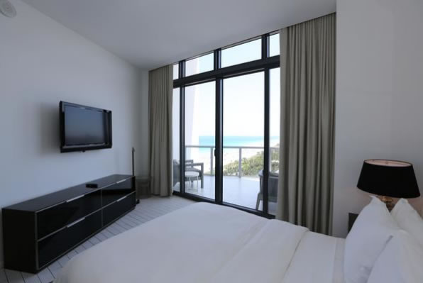 Bedroom with an ocean view at the W South Beach penthouse